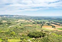 Landscape view from Chateau des Baux-de-provence. Landscape view of cultivated field from Chateau des Baux-de-provence in France under cloudy blue sky Stock Images