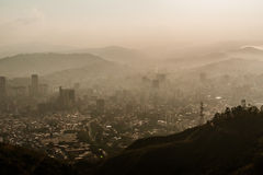 Landscape view of city of caracas during hazy sunset Royalty Free Stock Photo