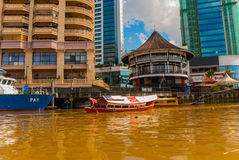 Landscape view of the city and Sarawak river. Local traditional boat for tourists. Kuching, Borneo, Malaysia Stock Images