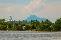 Landscape view of the city and Sarawak river. Museum of cats, and a mountain on the horizon. Kuching, Borneo, Malaysia Stock Photos