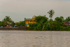 Landscape view of the city and Sarawak river. Small traditional local mosque. Kuching, Borneo, Malaysia Stock Image