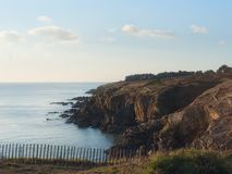 Brittany coast and sea in the evening. Landscape view of the coast in France Bretagne of cliff of Préfailles facing the Atlantic ocean Royalty Free Stock Photos