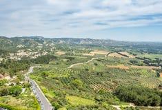 Landscape view from Chateau des Baux-de-provence. Landscape view of cultivated field from Chateau des Baux-de-provence in France under cloudy blue sky Royalty Free Stock Photo