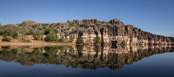 Landscape view of Devonian Cliffs, Geikie Gorge, Fitzroy Crossing. Stunning Devonian limestone cliffs of Geikie Gorge where the Fitzroy River carves its way royalty free stock images