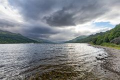 Loch earn. Landscape view of Dramatic summer clouds gathering over Loch Earn in the highlands of Scotland Royalty Free Stock Images