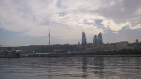Landscape view of the embankment of Baku, Azerbaijan, the Caspian Sea, skyscrapers and flaming towers stock video
