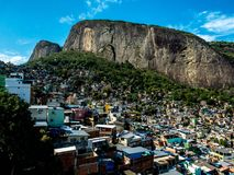 A landscape view of a famous rocinha favela under a rock in Rio de Janeiro, Brazil royalty free stock photo