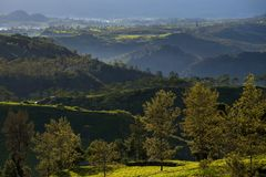Landscape view from giri peak, indonesia. Giri peak located at pengalengan, west java, indonesia. a tea plantation area surrounded with beautiful landscape stock images