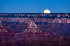 Landscape view of Grand canyon with rising moon, Arizona Royalty Free Stock Photos