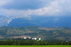 The landscape view of the High Tatra Mountains range. Storm clouds hide the peaks of the mountains royalty free stock photos