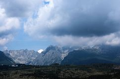 The landscape view of the High Tatra Mountains range. Storm clouds hide the peaks of the mountains stock image
