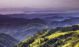 Hills of Monteverde. Landscape view of the hills of Monteverde in Costa Rica which extend to the ocean. Covered in green during the rainy season of December Stock Images