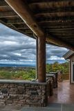 Landscape view from rustic wood and stone porch. stock photography