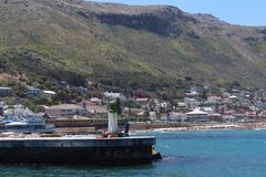 A landscape view of Kalk Bay Harbour in Cape Town stock photos