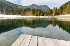 Landscape view of lake and mountains from the wooden pier Royalty Free Stock Photos
