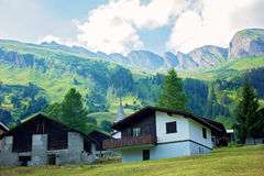 Landscape view of a little village in Swiss Alps on sunset Royalty Free Stock Photo