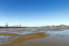 Low Tide and Blue Sky in Durban Harbor royalty free stock images