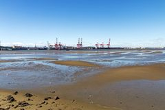Low Tide and Blue Sky in Durban Harbor Royalty Free Stock Image