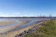 Low Tide and Blue Sky in Durban Harbor Stock Image