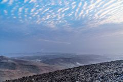 Landscape view on magic sunrise over holy land judean negev desert in Israel. Colorful pink clouds, mountains and blue sky. Beautiful dawn of nature Royalty Free Stock Photos