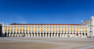 Landscape view of magnificent building in huge Praca Del Comercio Square in Lisbon. Landscape view of magnificent building defining one side the of the huge Royalty Free Stock Photo