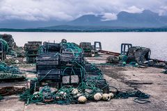 Landscape view of many fishermen traps stacked in rows on the sh. Ore near the harbour. Galway, Ireland royalty free stock images