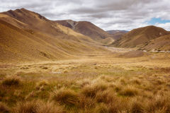 Landscape view of meadows and hills at Lindis Pass, NZ. Landscape view of meadows and hills at Lindis Pass, New Zealand Stock Photography