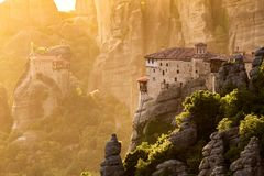 Meteora rock landcape sunset Greece. Landscape view of the Meteora rock mountain formations in the Pindos Mountains, Greece, during sunset stock photos
