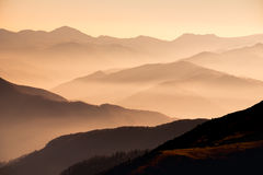 Landscape view of misty mountain hills at sunset Royalty Free Stock Image