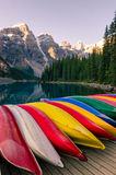 Landscape view of Moraine lake with colorful boats, Rocky Mountains Stock Photography