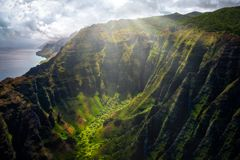 Landscape view of Na Pali coastline cliffs with sunlight glow, Kauai, Hawaii. USA royalty free stock photo