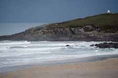 A Landscape View of North Fistral Headland including the Ocean and Sandy Beach Shore Stock Images