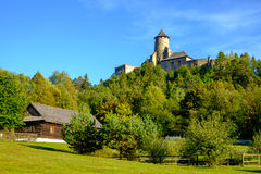 Landscape view of old traditional house and castle, Slovakia stock images