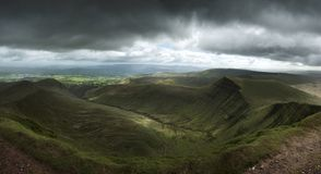 Landscape view from Pen y fan peak in Brecon Beacons with dark m Royalty Free Stock Photography