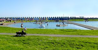 Hove Lagoon. Landscape view of people enjoying the facilities at Hove Lagoon, an outdoor leisure center located in Brighton and Hove, East Sussex, England Royalty Free Stock Image