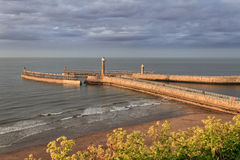 Landscape view of the pier and lighthouse in Whitby Stock Images