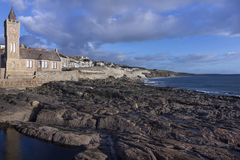 Porthleven clock tower and tide pools royalty free stock photo