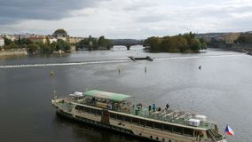 Landscape view of Prague Bridge and Boat Floating on the River Vitava stock video
