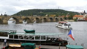 Landscape view of Prague Bridge and Water Bus Boat Floating on the River Vitava stock footage