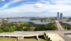 Landscape view of Putrajaya Pullman lakeside. And dam from high angle view with white and blue skies during daytime Royalty Free Stock Images