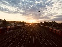 Landscape View of Railway Station during Sunrise Stock Images