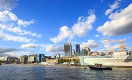 A bright summer day on the River Thames with many iconic buildings and a bright blue cloudy sky, London Royalty Free Stock Photography