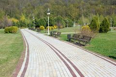 Landscape with a View on a Road Paved with Slabs. An alley paved with slabs in Botanical Garden of Kyiv, Ukraine Stock Photo