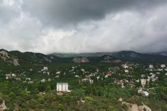 Landscape view from the rock Diva on the resort village Simeiz. Over the tops of the mountains hanging rain clouds. Soon it`s gonna rain royalty free stock photos