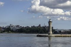 Roosevelt island Lighthouse. A landscape view of the Roosevelt Island lighthouse, formerly known as the Blackwell Island lighthouse stock images