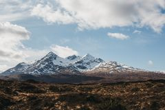Landscape view of Scottish Highlands, Scotland. Landscape view of Scottish Highlands, Scotland, cloudy blue sky and snow capped mountains on the background stock images