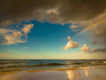 Landscape view on sky with rainbow at sea. Royalty Free Stock Images