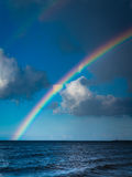 Landscape view on sky with rainbow at sea. Royalty Free Stock Photos