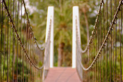 Landscape view of Steel Suspension bridge with bokeh Royalty Free Stock Image