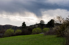 Landscape view of a stormy sky and green meadow Royalty Free Stock Photos
